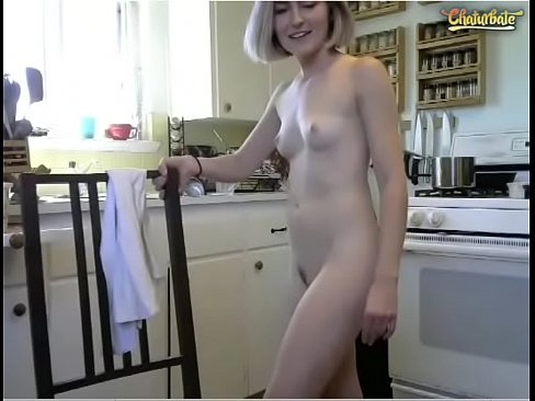 Picture of a naked girl cooking